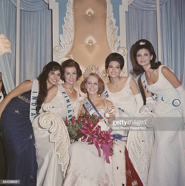 The winner of the 1966 Miss Universe beauty pagent Margareta Arvidsson of Sweden is pictured wearing a crown in centre with from left runners up...