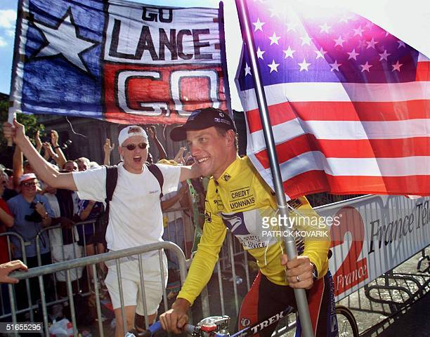 The winner of the 1999 Tour de France American Lance Armstrong is supported by spectators during his honour lap on the Champs Elysees in Paris 25...