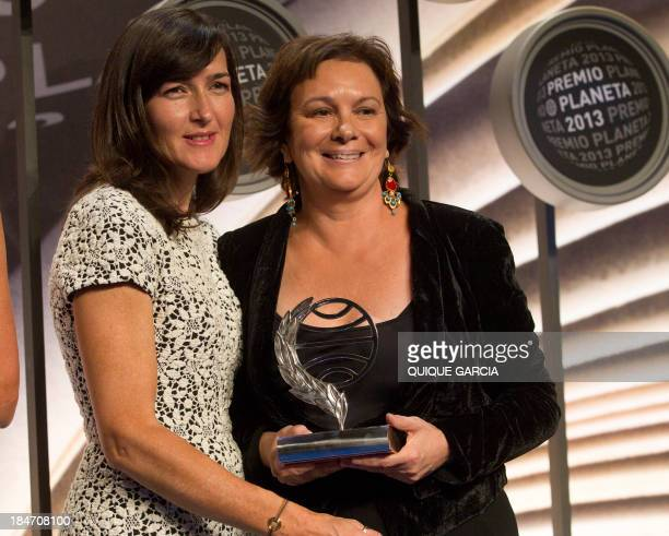 The winner of the 2014 Premio Planeta literature award Spanish writer Clara Sanchez poses with finalist Angeles GonzalezSinde during the ceremony of...