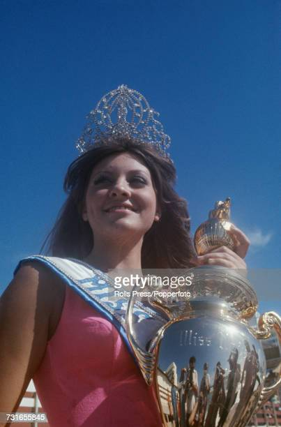 The winner of the Miss Universe 1971 beauty pagent Georgina Rizk of Lebanon is pictured holding the Miss Universe trophy outside the Miami Beach...