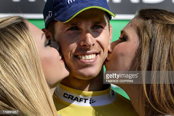 The winner of the Tour of Switzerland Portugal's Rui Costa is kissed during the podium ceremony after his victory in the final stage a 268 km time...