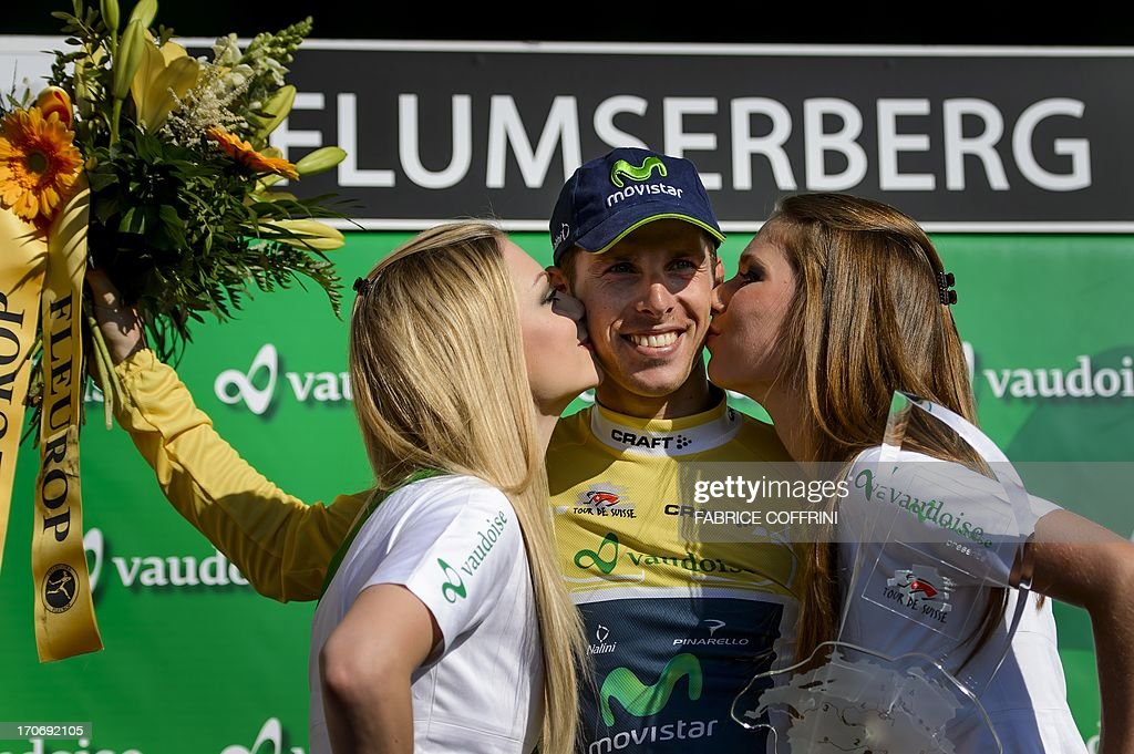 The winner of the Tour of Switzerland, Portugal's Rui Costa (Movistar) is kissed during the podium ceremony after his victory in the final stage, a 26,8 km time trial between Bad Ragaz and Flumserberg on June 16, 2013.