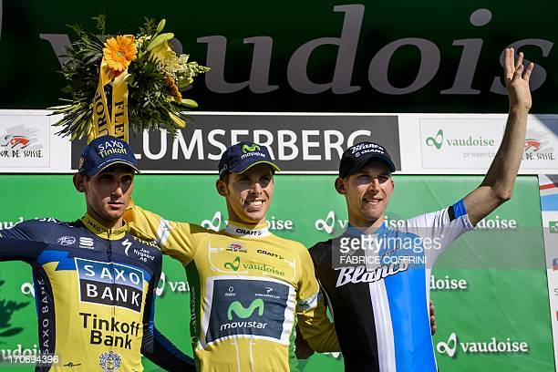 The winner Portugal's Rui Costa poses with overall second Dutch Bauke Mollema and third placed Czech Roman Kreuziger during the podium ceremony of...
