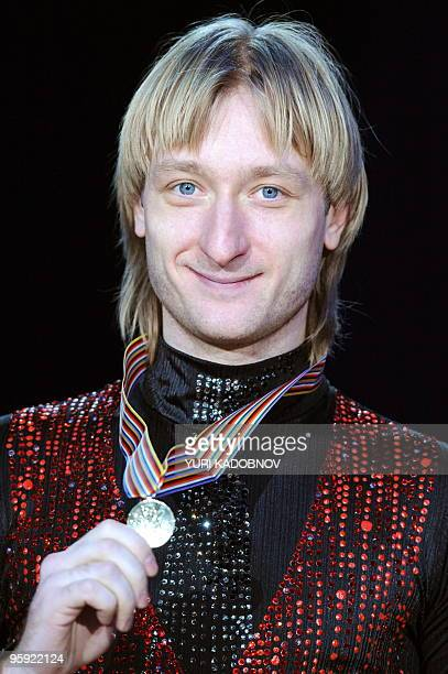 The winner Russia's Olympic champion Yevgeny Plushenko poses during the medal ceremony of Men's event at the 2010 European Figure Skating...