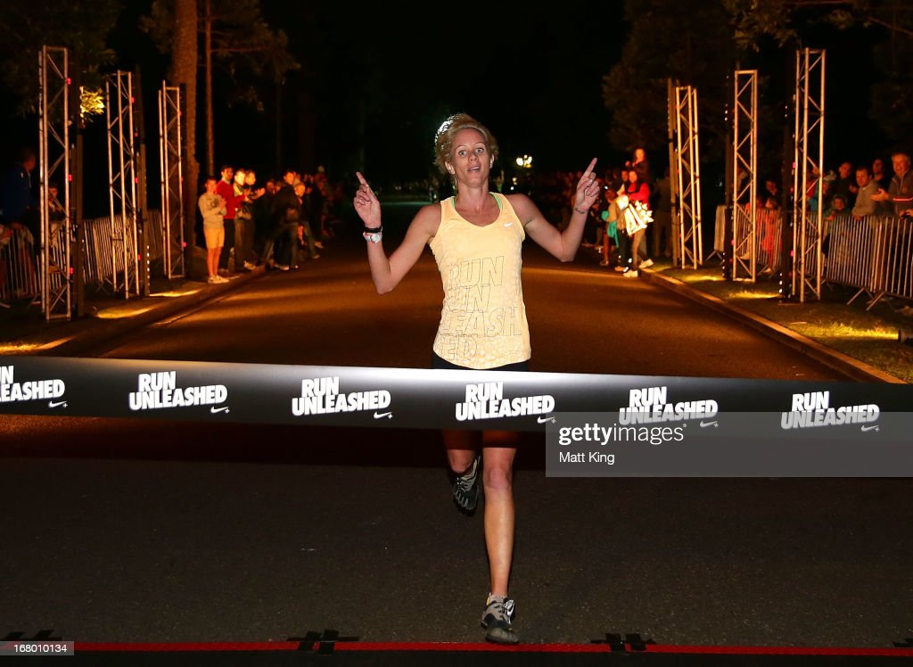 The winner <a gi-track='captionPersonalityLinkClicked' href=/galleries/search?phrase=Victoria+Mitchell&family=editorial&specificpeople=795232 ng-click='$event.stopPropagation()'>Victoria Mitchell</a> who finished in 34.09 crosses the finish line during Nike She Runs 10k at Centennial Park on May 4, 2013 in Sydney, Australia.