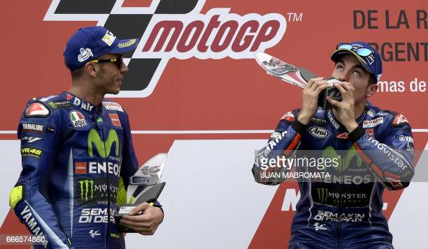 The winner Yamaha Spanish biker Maverick Vinales and 2nd placed also from YamahaItalian Valentino Rossi celebrate on the podium of the MotoGP race of...