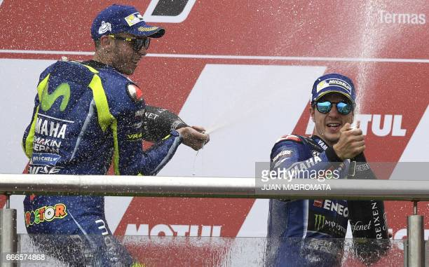 The winner Yamaha Spanish biker Maverick Vinales and 2nd placed also from YamahaItalian Valentino Rossi spray champagne on the podium of the MotoGP...