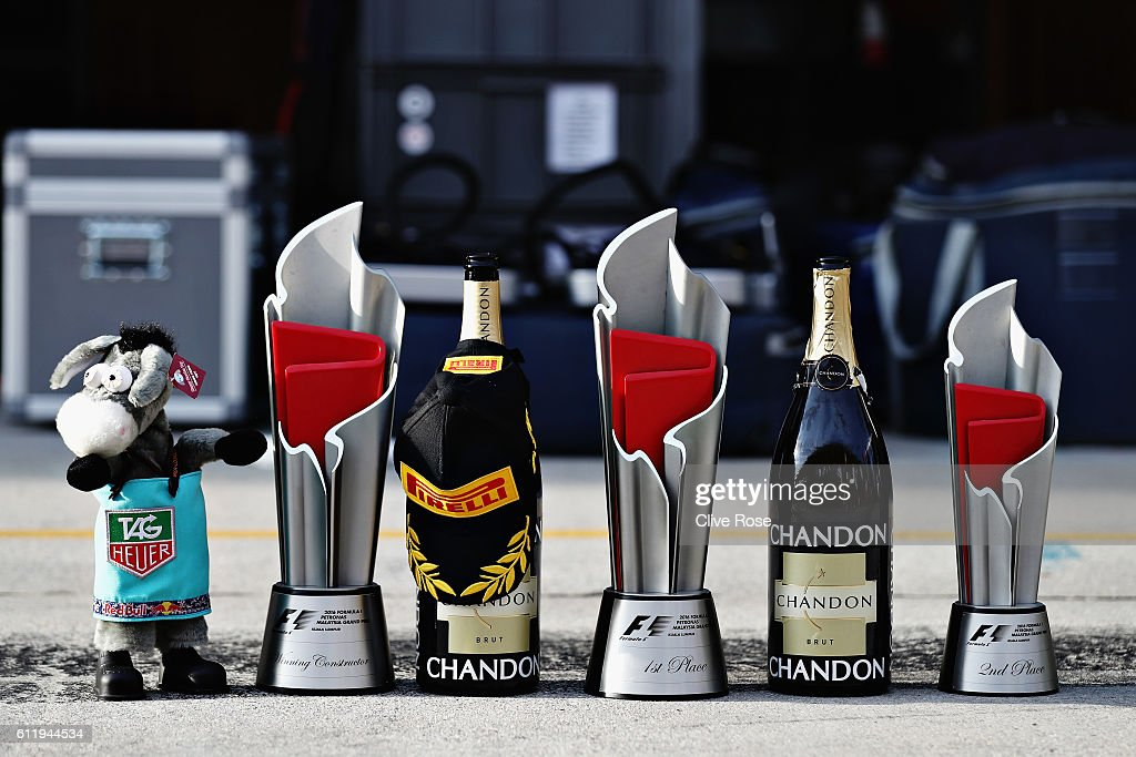 The winners, constructors and 2nd place trophies of Daniel Ricciardo of Australia and Red Bull Racing and Max Verstappen of Netherlands and Red Bull Racing during the Malaysia Formula One Grand Prix at Sepang Circuit on October 2, 2016 in Kuala Lumpur, Malaysia.