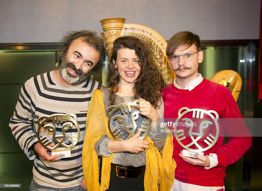 The winners of the 18th edition of the Hivos Tiger Awards (From LtoR), filmmakers Mohammad Shirvani (fro the film Fat Shaker), Mira Fornay (for the film My Dog Killer) and Daniel Hoesl (for the film Soldier Jane) pose with their trophies, on February 1, 2013 in Rotterdam, in the Netherlands. The yearly awards took place at the International Film Festival Rotterdam. AFP PHOTO / ANP / ROBERT VOS netherlands out