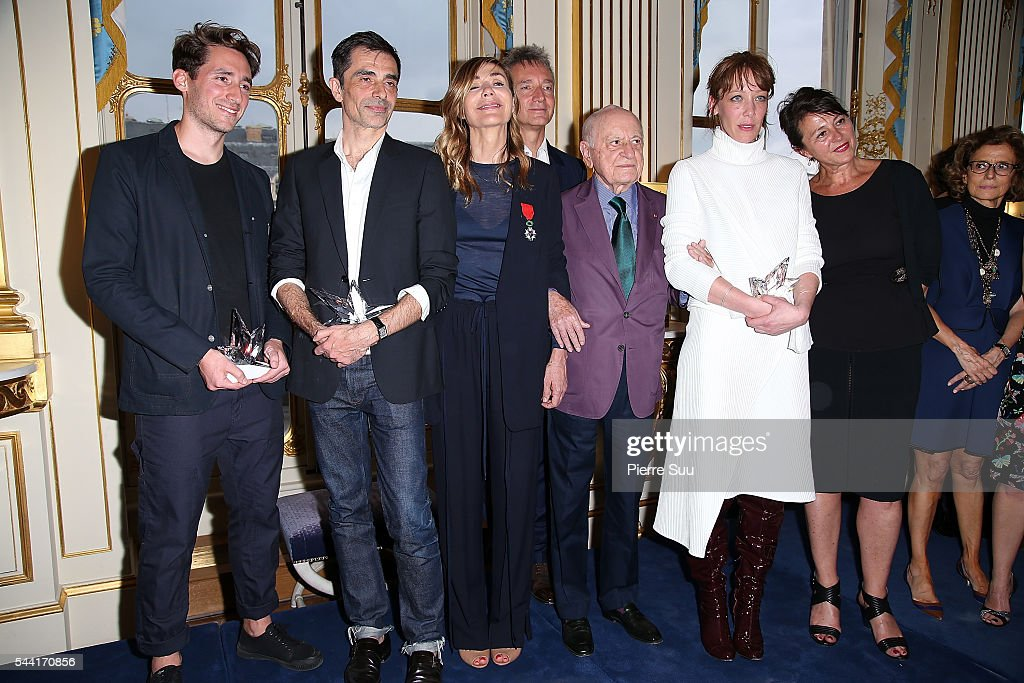 The Winners of The 2016 ANDAM Awards pose with members of the jury at Ministere de la Culture on July 1, 2016 in Paris, France.