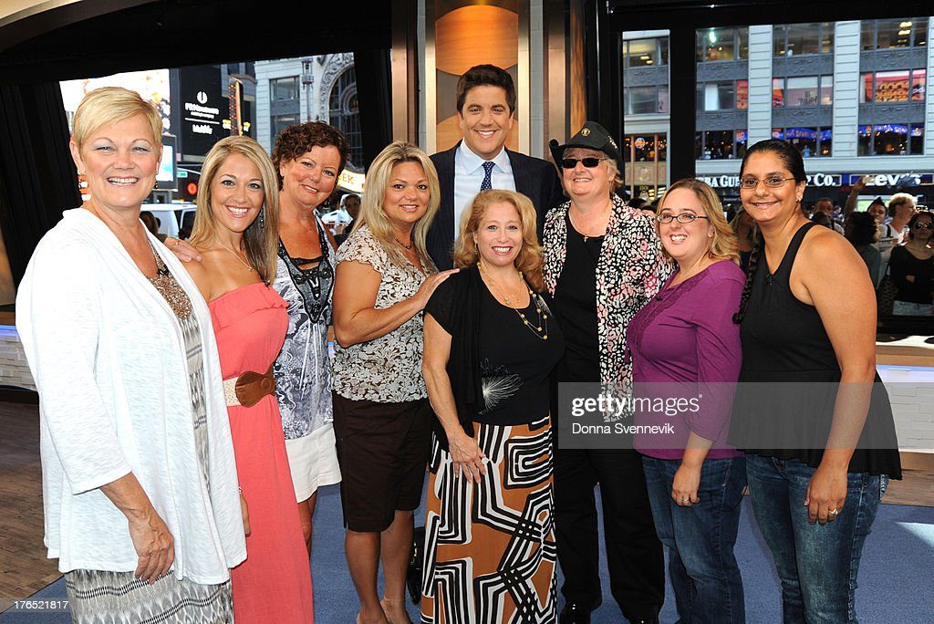 AMERICA - The winners of the $448 million Powerball jackpot, all employees of 16 Ocean County Vehicle Maintenance in Tom's River, NJ, appear on 'Good Morning America,' 8/13/13, airing on the ABC Television Network. JOSH ELLIOTT WITH OCEAN