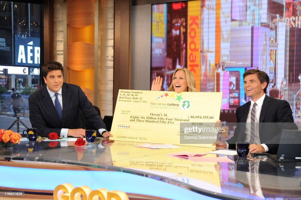 AMERICA - The winners of the $448 million Powerball jackpot, all employees of 16 Ocean County Vehicle Maintenance in Tom's River, NJ, appear on 'Good Morning America,' 8/13/13, airing on the ABC Television Network. STEPHANOPOULOS