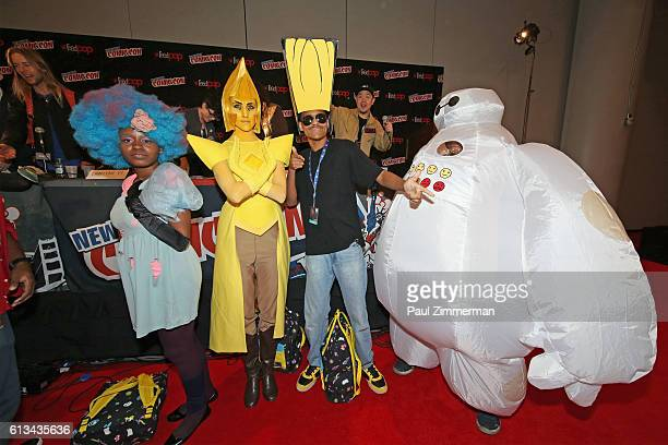 The winners of the Cartoon Network Costume Ball cosplay contest pise at the Cartoon Network Costume Ball Screening at New York Comic Con on October 8...