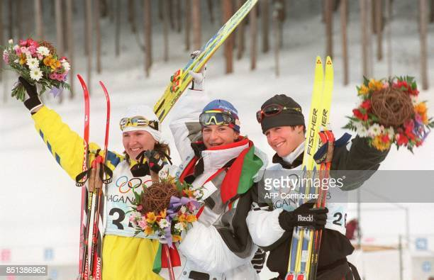 The winners of the women's Olympic 15km individual biathlon from L to R silver medalist Elena Petrova of Ukraine gold medalist Ekaterina Dafovska of...