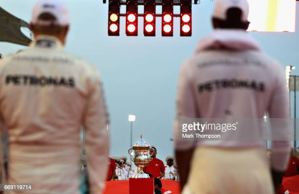 The winners trophy in front of Lewis Hamilton of Great Britain and Mercedes GP and Valtteri Bottas of Finland and Mercedes GP on the grid before the...