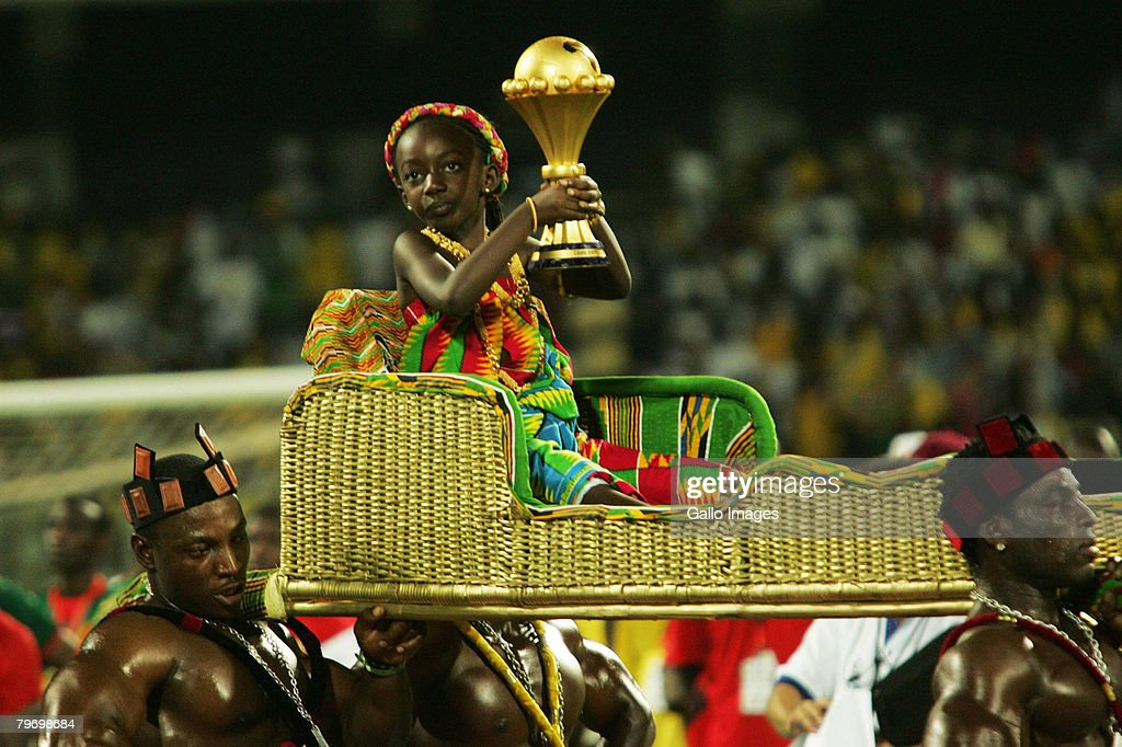 The winners' trophy is carried on to the pitch after the AFCON Final match between Cameroon and Egypt at the Ohene Djan Stadium in Accra Ghana