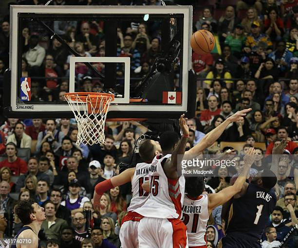TORONTO JANUARY 18 The winning basket was thrown up by Pelican's Tyreke Evans despite the defence of three Raptors Jonas Valanciunas Greivis Vasquez...
