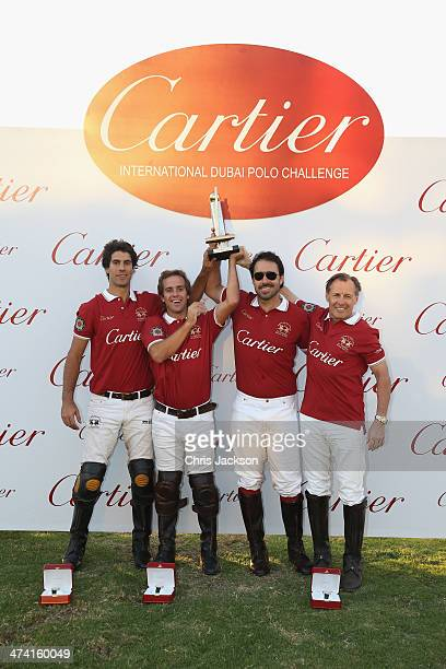 The winning 'Cartier' team pose with their trophy on the final day of the Cartier International Dubai Polo Challenge 9th edition at Desert Palm Hotel...