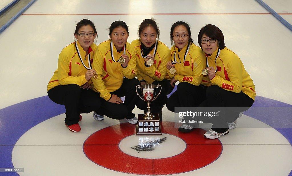 The winning China team of Bingyu Wang, Yin Liu, Qingshuang Yue, Yan Zhou and Jinli Liu pose for a photo at the Pacific Asia 2012 Curling Championship at the Naseby Indoor Curling Arena on November 25, 2012 in Naseby, New Zealand.