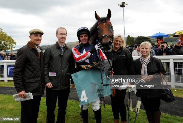 The winning connections of Drumlang with jockey Robert McCarth after winning the William Hill On Your Mobile Handicap Steeple Chase at Cartmel...