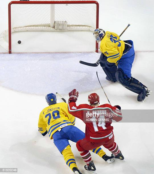 The winning goal for Belarus shot by Vladimir Kopat trickles in after it bounced off Sweden's goalie Tommy Salo near the end of the third period of...