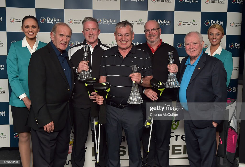 The winning Team Emirates, Jonathan Adair, Jonathan Millar and Tom Donahoe are presented with their trophies by Dubai Duty Free executive vice chairman Colm McLoughlin (2nd L) and Dubai Duty Free chairman George Horan (2nd R) at the prizegiving ceremony held in the sponsors pavillion during the Pro-Am round prior to the Dubai Duty Free Irish Open hosted by the Rory Foundation at Royal County Down Golf Club on May 27, 2015 in Newcastle, Northern Ireland.
