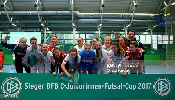 The winning team of 1 FC Koeln celebrates with the trophy after winning 10 the C Junior Girl's German Futsal Championship final against SC Bad...