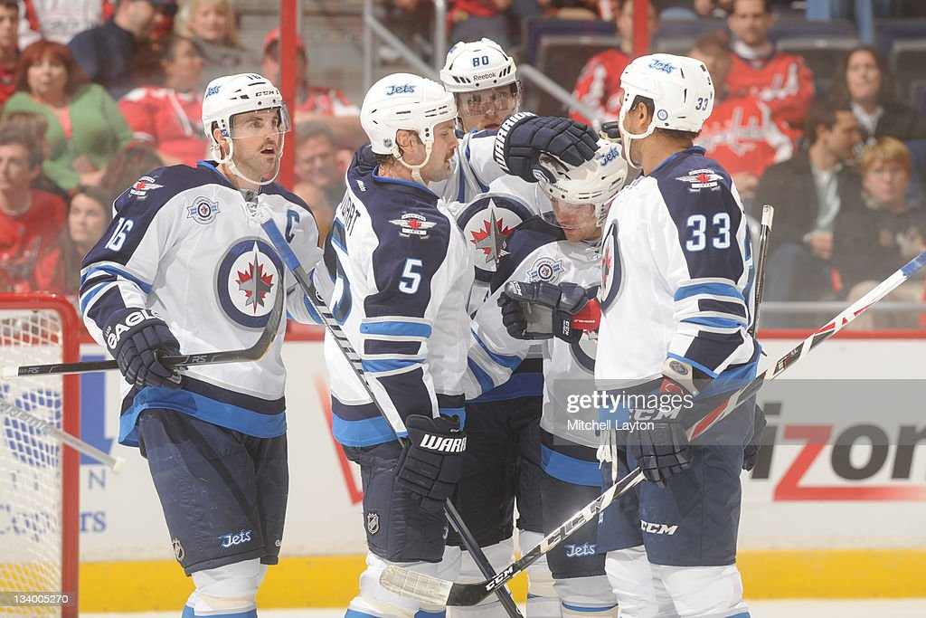 The Winnipeg Jest celebrate after their first goal during a NHL hockey game against the Washington Capitals on November 23, 2011 at the Verizon Center in Washington, DC.