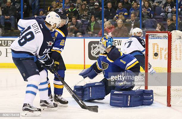 The Winnipeg Jets' Bryan Little left scores past St Louis Blues goaltender Brian Elliott in the second period on Tuesday Feb 9 at the Scottrade...