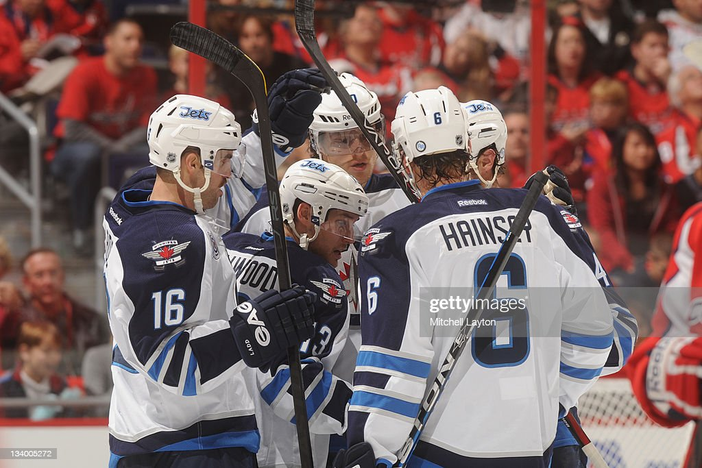 The Winnipeg Jets celebrate after their second goal of a NHL hockey game against the Washingon Capitals on November 23, 2011 at the Verizon Center in Washington, DC.