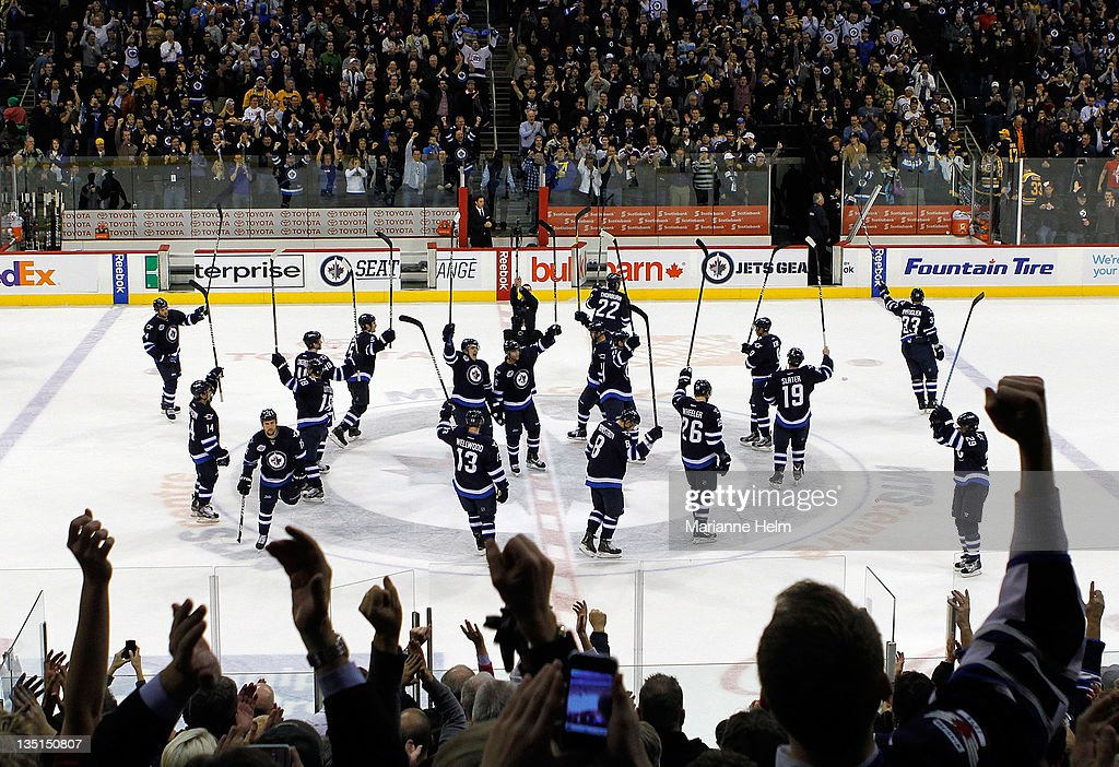 The Winnipeg Jets salute the fans after defeating the Boston Bruins 2-1 in NHL action at the MTS Centre on December 6, 2011 in Winnipeg, Manitoba, Canada.