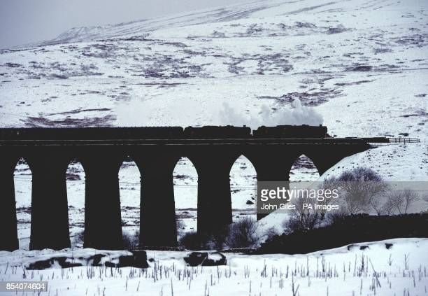 The Winter Cumbrian Mountain Express the first of 2013 crosses the viaduct across the valley of the River Ribble at Ribblehead in North Yorkshire at...