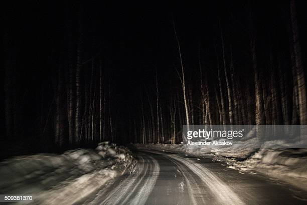 The winter road at night near the Siberian village of Yangutum on February 2 2016 in Siberia Russia Local people live in this 'winter' community to...