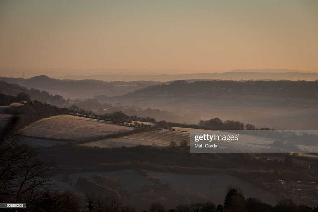 The winter sun begins to rise over frost and mist in the valley of St Catherine near Bath on December 29, 2014 in Bath and North East Somerset, England. According to the Met Office Britain experienced the coldest night of the year overnight, with some areas being even colder than Alaska and the Antarctica and as forecasters believe it could get even colder tonight, a Met Office cold weather alert for northern England and the Midlands has warned of health risks for vulnerable people.
