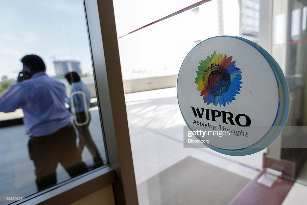 The Wipro Ltd. logo is displayed on a glass door at the company's campus in Bangalore, India, on Tuesday, Jan. 28, 2014. Worldwide spending on information technology will grow 3.1 percent to $3.8 trillion this year, with IT services set to climb 4.5 percent, researcher Gartner Inc. forecast Jan. 6. Photographer: Vivek Prakash/Bloomberg via Getty Images