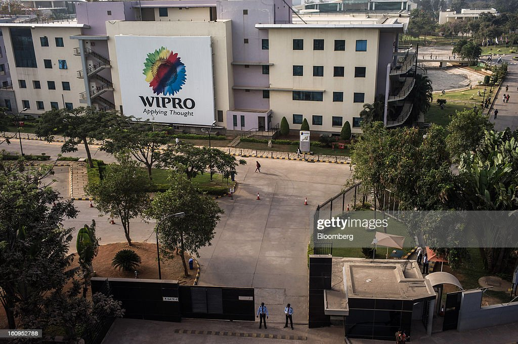 The Wipro Ltd. logo is displayed on the side of the company's offices in Bangalore, India, on Monday, Feb. 4, 2013. Wipro forecast information-technology services revenue in the range of $1.59 billion and $1.63 billion in the quarter through March. Photographer: Sanjit Das/Bloomberg via Getty Images
