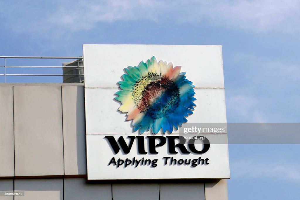 The Wipro Ltd. logo sits atop a building at the company's campus in Bangalore, India, on Tuesday, Jan. 28, 2014. Worldwide spending on information technology will grow 3.1 percent to $3.8 trillion this year, with IT services set to climb 4.5 percent, researcher Gartner Inc. forecast Jan. 6. Photographer: Vivek Prakash/Bloomberg via Getty Images