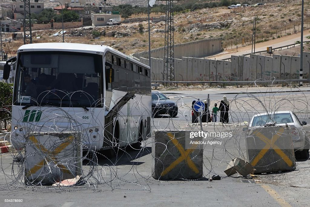The wire fence is seen as Israeli security forces increase the security measures around Hizma district of Jerusalem on May 26, 2016.