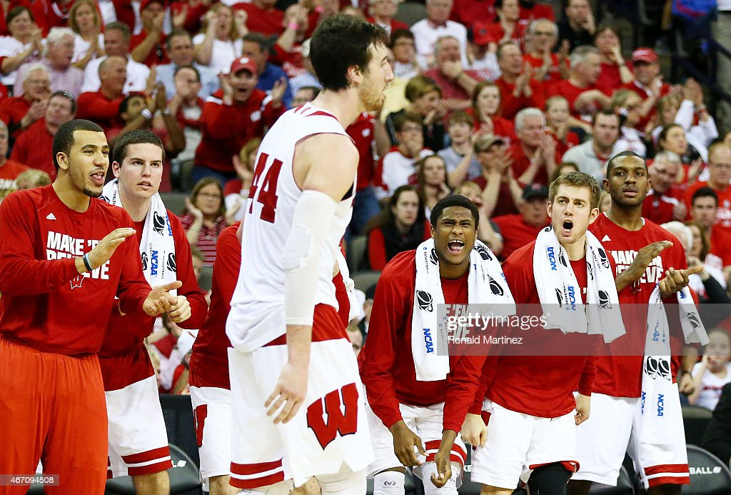The Wisconsin Badgers bench cheers for <a gi-track='captionPersonalityLinkClicked' href=/galleries/search?phrase=Frank+Kaminsky&family=editorial&specificpeople=8685398 ng-click='$event.stopPropagation()'>Frank Kaminsky</a> #44 of the Wisconsin Badgers in the second half against the Coastal Carolina Chanticleers during the second round of the 2015 NCAA Men's Basketball Tournament at the CenturyLink Center on March 20, 2015 in Omaha, Nebraska.