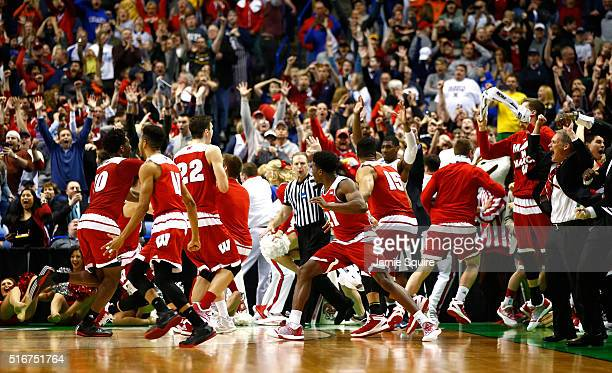 The Wisconsin Badgers celebrate after defeating the Xavier Musketeers on a buzzer beater game winning basket by Bronson Koenig during the second...