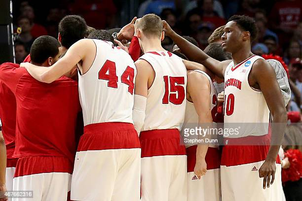 The Wisconsin Badgers huddle before taking on the North Carolina Tar Heels during the West Regional Semifinal of the 2015 NCAA Men's Basketball...