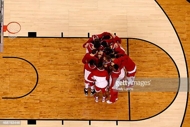 The Wisconsin Badgers huddle before their game against the Duke Blue Devils during the NCAA Men's Final Four National Championship at Lucas Oil...