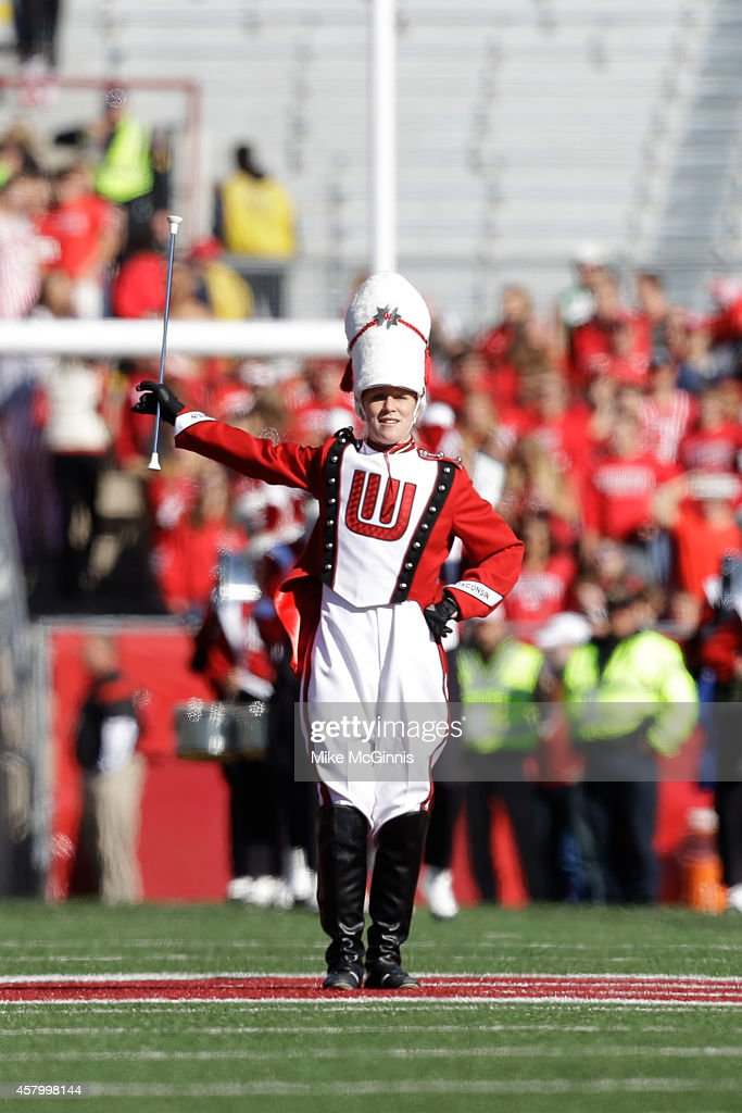The Wisconsin Badgers marching band takes the field before the game between the Illinois Fighting Illini and the game against the Wisconsin Badgers at Camp Randall Stadium on October 11, 2014 in Madison, Wisconsin.