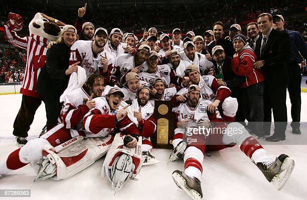 The Wisconsin Badgers pose with the trohpy after the NCAA Men's Frozen Four Championship game on April 8 2006 at the Bradley Center in Milwaukee...