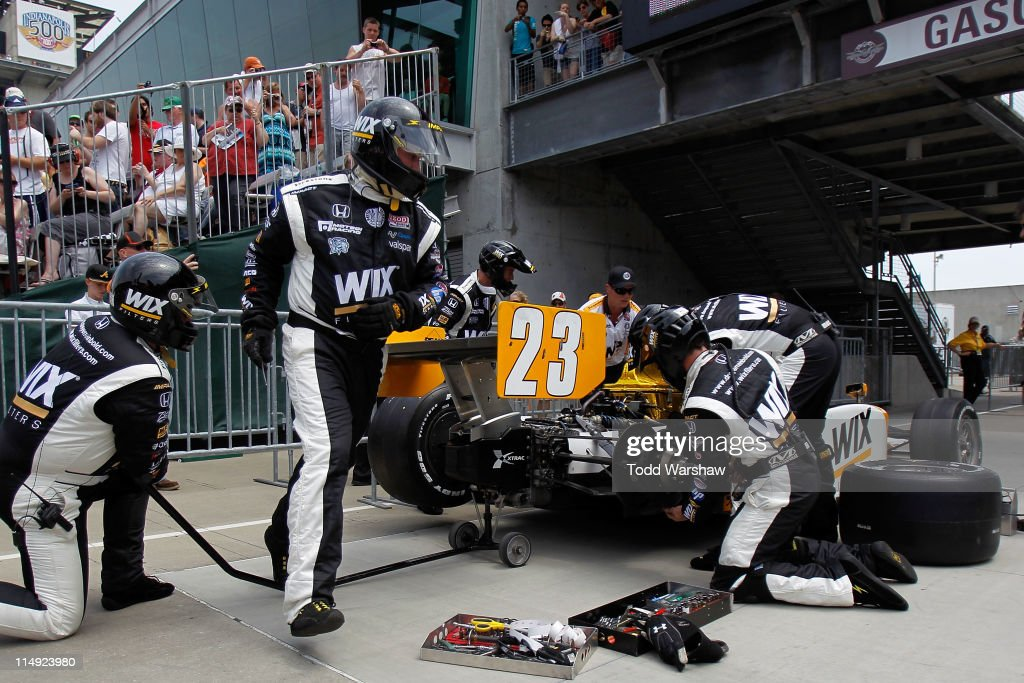 The #23 Wix Dallara Honda driven by <a gi-track='captionPersonalityLinkClicked' href=/galleries/search?phrase=Paul+Tracy&family=editorial&specificpeople=179458 ng-click='$event.stopPropagation()'>Paul Tracy</a> of Canada is serviced after crashing during the IZOD IndyCar Series Indianapolis 500 Mile Race at Indianapolis Motor Speedway on May 29, 2011 in Indianapolis, Indiana.