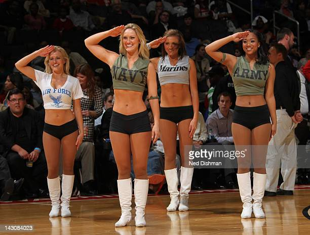The Wizard Girls dance team salute the military during military appreciation night at the Washington Wizards game against the Milwaukee Bucks during...