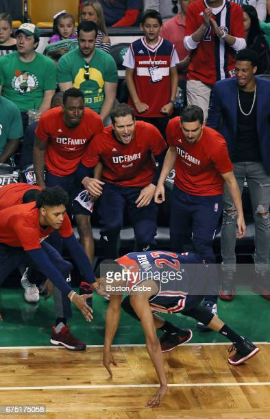 The Wizards bench erupts in smiles when teammate Otto Porter lands in front of them after he fell down while hitting a fall away shot The bucket put...