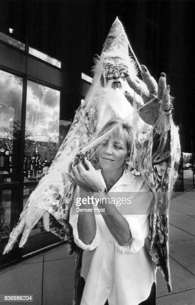 The Wizard's chest Owner Betty Arca puts a 'spider' in the webs of her Wizard that stand outside her Cherry Creek store Credit The Denver Post
