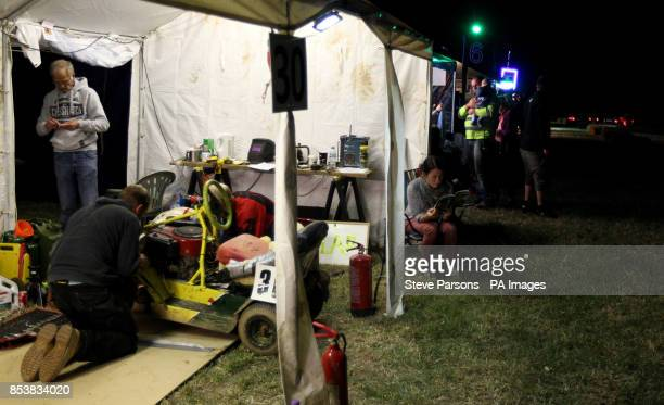 The Wizi Greeners team work on their mower during the British Lawn Mower Racing Association 12 hour British Lawn mower endurance race near...