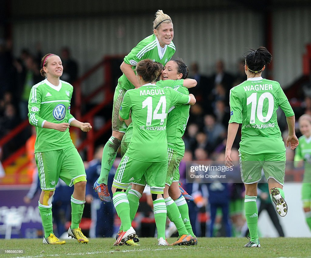 The Wolfsburg players celebrate after their team-mate Martina Muller socred a goal during the UEFA Women's Champions League Semi Final First Leg match between Arsenal Ladies and VFL Wolfsburg at Meadow Park on April 14, 2013 in Borehamwood, England.